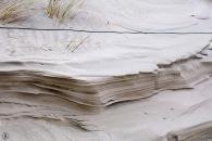 Eine Sandskulptur, geformt vom Wind